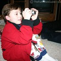 6-year-old Dylan taking pictures with his new digital camera.