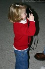 Karly trying out Daddy's film camera.