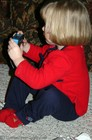 3 year old Karly taking pictures with her new FILM camera... Karly got two cameras this Christmas... one digital camera from us, and one film camera from Grandma.