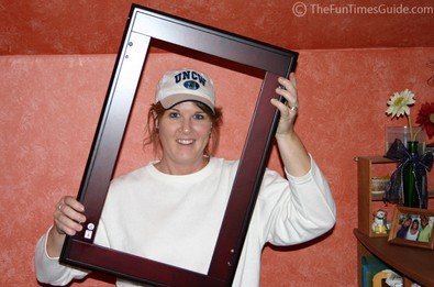 Lynnette holding what looks like a picture frame.