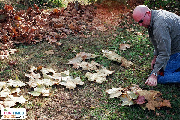 Jim strategically placing leaves to spell out 'Nashville' on the ground
